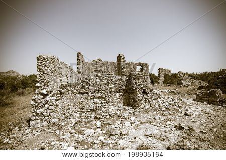 Ancient ruins of Aspendos. Turkey. Stylization. Sepia. Vignetting.