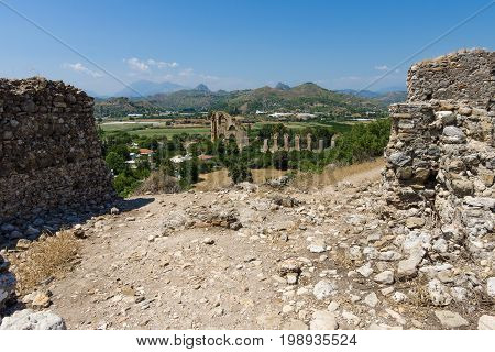 Ancient ruins of Aspendos. In the background the aqueduct. Turkey.