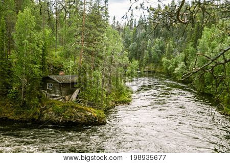 A Beautiful Scenery With A River Rapids In Finland