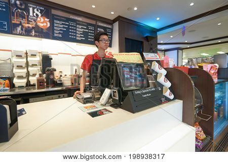 HONG KONG - JANUARY 28, 2016: young male cafe worker at Pacific Coffee. Pacific Coffee Company is a Pacific Northwest U.S.- style coffee shop group originating from Hong Kong