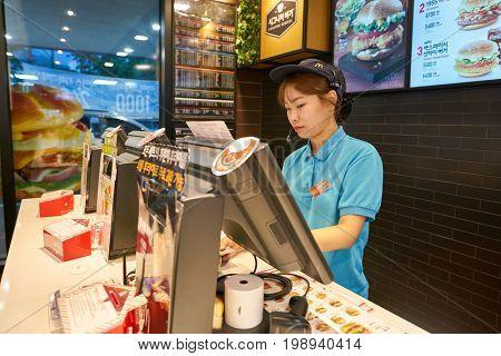 BUSAN, SOUTH KOREA - CIRCA MAY, 2017: worker at McDonald's. McDonald's is an American hamburger and fast food restaurant chain.