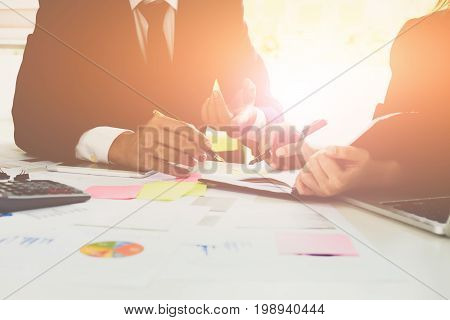 Close-up Of Business Man And Partner Hands Pointing At Turnover Graph While Discussing It Using Lapt