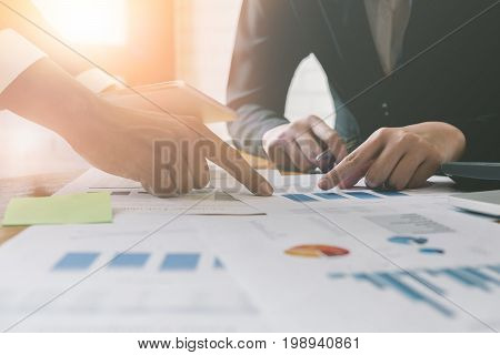Close Up Image Group Of Business People Busy Discussing Financial Matter During Meeting