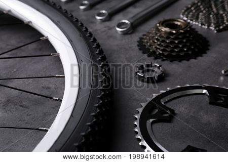 Bicycle parts and tools on gray background