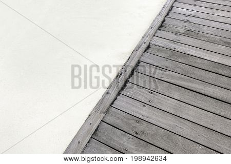 Part of wooden pontoon and sand on beach in summer day