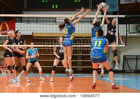 KAPOSVAR, HUNGARY - JANUARY 23: Zsofia Harmath (3) blocks the ball at the Hungarian NB I. League woman volleyball game Kaposvar vs Miskolc, January 23, 2011 in Kaposvar, Hungary.