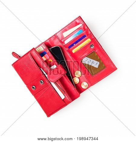 Open wallet with credit cards smartphone and pin code on sticky note isolated on white background. Female red purse. Object with clipping path flat lay