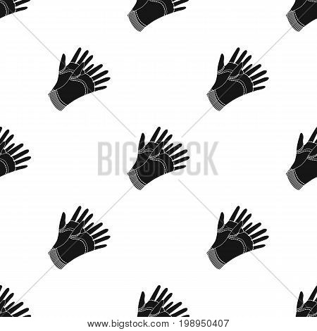 Garden gloves to work with the land in the garden. Protective gardener clothing.Farm and gardening single icon in black style vector symbol stock web illustration.