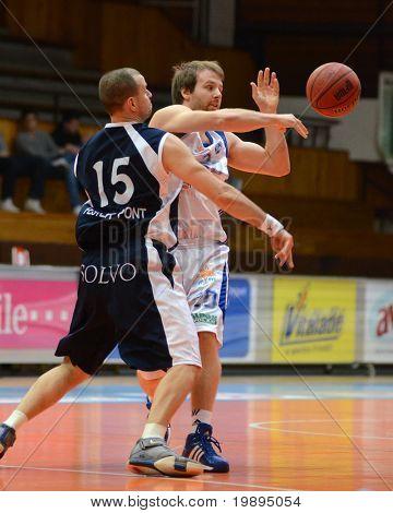 KAPOSVAR, HUNGARY - JANUARY 26: Joshua Wilson (R) in action at a Hugarian Cup basketball game Kaposvar vs. Szeged January 26, 2011 in Kaposvar, Hungary.