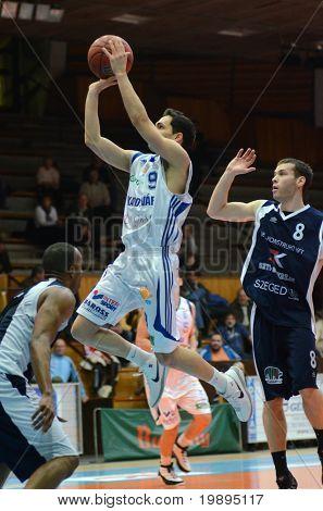 KAPOSVAR, HUNGARY - JANUARY 26: Tamas Markus (L) in action at a Hugarian Cup basketball game Kaposvar vs. Szeged January 26, 2011 in Kaposvar, Hungary.