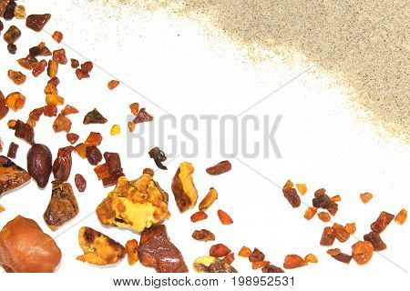 Eight different pieces of amber on a white background. Amber of various colors and structure and shapes. Transparent and opaque pieces of amber. Natural amber