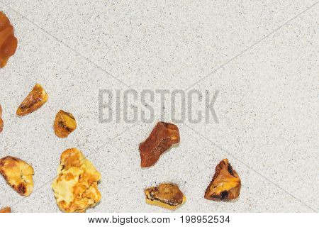 Amber. the pieces of amber in the sand on the beach. Sun stone natural mineral on the beach. Amber Shine on the beach. Amber Baltic sand