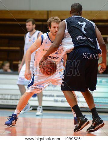 KAPOSVAR, HUNGARY - JANUARY 26: Joshua Wilson (C) in action at a Hugarian Cup basketball game Kaposvar vs. Szeged January 26, 2011 in Kaposvar, Hungary.