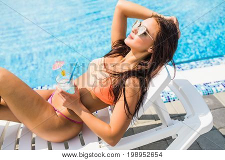 Young Beautiful Woman Enjoying Summer Vacation. Beautiful Young Woman In Yellow Dress Holding Glass