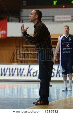 KAPOSVAR, HUNGARY - JANUARY 26: Adam Fekete (L) (Kaposvar trainer) in action at a Hugarian Cup basketball game Kaposvar vs. Szeged January 26, 2011 in Kaposvar, Hungary.