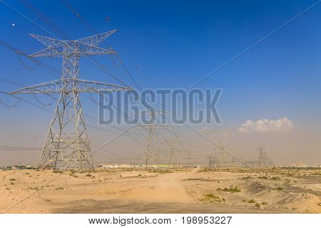 Electric grid lines in desert. Electric transmission lines in the desert.