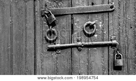 Old door fittings on the wooden door Black and white