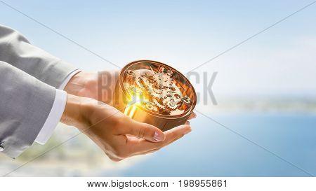Clockwork in palm. Mixed media