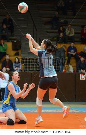 KAPOSVAR, HUNGARY - FEBRUARY 13: Gabriella Kondor (13) receives the ball at the Hungarian NB I. League woman volleyball game Kaposvar vs Bekescsaba, February 13, 2011 in Kaposvar, Hungary.