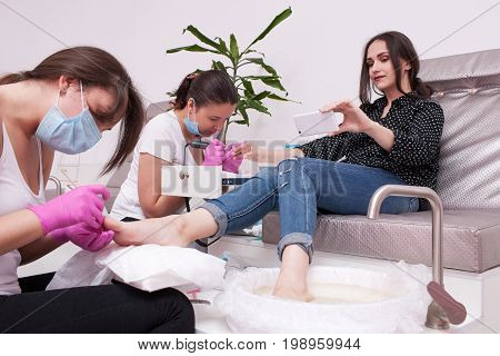 Simultaneous gel polish manicure and pedicure selfie. Professional body care for beauty and health in salon.