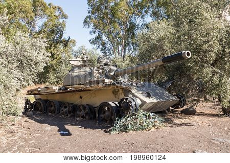 A battered Syrian tank of Soviet manufacture is after the Doomsday (Yom Kippur War) on the Golan Heights in Israel near the border with Syria