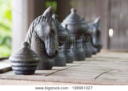 Chess horse made of black wood on board