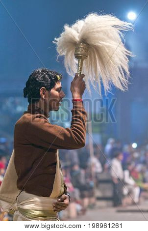 VARANASI, INDIA - JANUARY 3, 2016: Indian Brahmin conduct religious Ganga Maha Aarti ceremony at Dashashwamedh Ghat in Varanasi, Uttar Pradesh