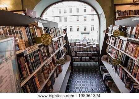 ST.PETERSBURG, RUSSIA - JUNE 1, 2017: Shelves with books in the bookstore in Book House or House of Book or Singer House on Nevsky Prospect in St Petersburg, Russia