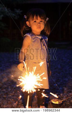 Japanese Girl Doing Handheld Fireworks (2 Years Old)