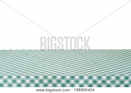 Empty table with green tablecloth isolated on white background for food and product display montage