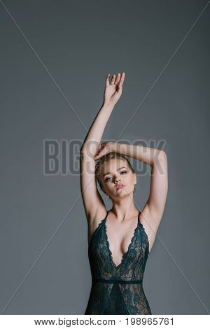 Sensual Attractive Young Girl With Slim Body Posing In Green Lace Leotard, Isolated On Grey