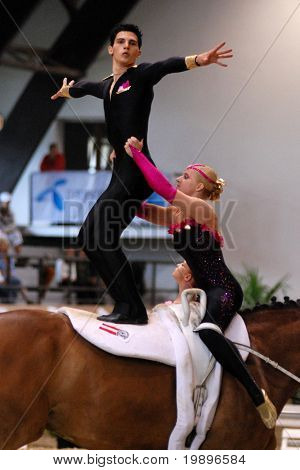 KAPOSVAR, HUNGARY - AUGUST 12: Austrian team in action at the Vaulting World Championship Final on August 12, 2007 in Kaposvar, Hungary.