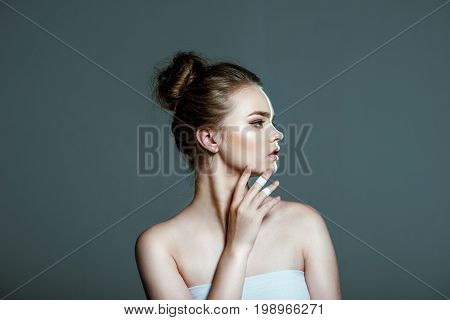 Young Beautiful Tender Girl Posing With Creative White Body Art Line On Face, Isolated On Grey