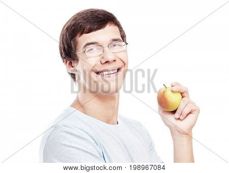 Close up portrait of young hispanic man in glasses and t-shirt smiling perfect toothy smile and holding fresh apple in his hand isolated on white background - education or healthy lifestyle concept
