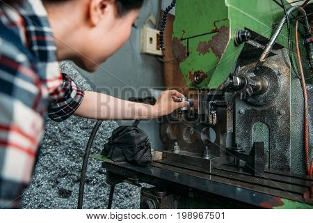 Staff Put Finished Parts Into Industrial Machine