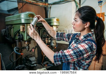 Female Worker Holding Silver Parts Components