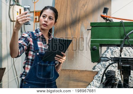 Milling Machine Female Employee Holding Mobile Pad