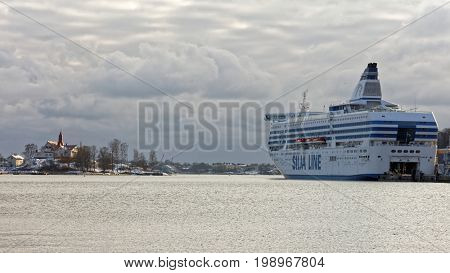 HELSINKI, FINLAND - NOVEMBER 4, 2016: Cruiseferry Symphony of Tallink Silja Line moored at Olimpia terminal. Built in 1991, the ship has passenger capacity of 2800