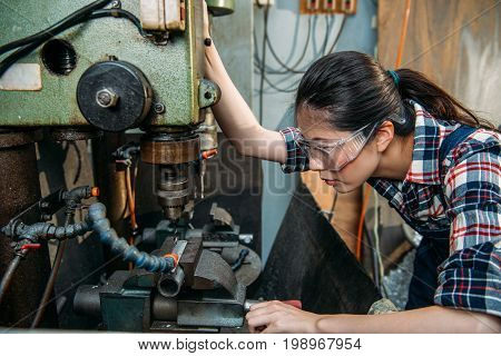 Factory Woman Wearing Safety Protection Glasses