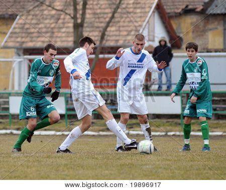 KAPOSVAR, HUNGARY - MARCH 5: Krisztian Kirchner (L) in action at the Hungarian National Championship under 19 game between Kaposvar and MTK on March 5, 2011 in Kaposvar, Hungary.
