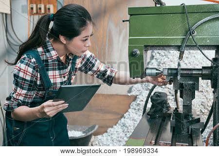 Lathe Worker Manager Holding Mobile Pad Computer