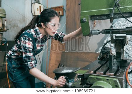 Young Lathe Company Woman Worker Wearing Goggles