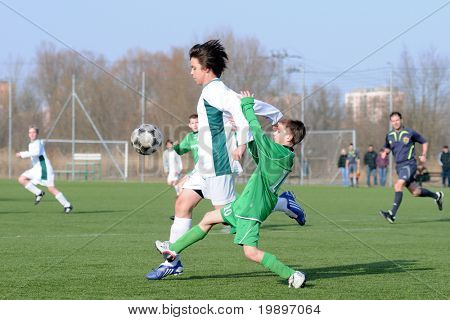 KAPOSVAR, HUNGARY - MARCH 9: Bence Szabo (in white) in action at the Hungarian National Championship under 13 game between Kaposvar and Airnergy FC on March 9, 2011 in Kaposvar, Hungary.