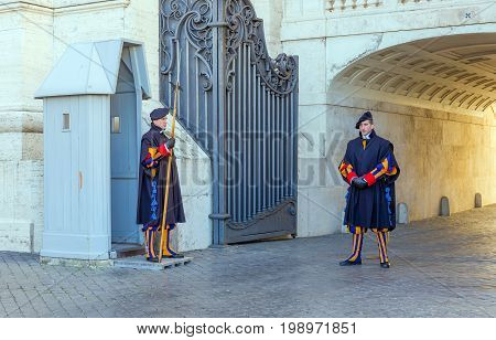VATICAN CITY, VATICAN - DECEMBER 31, 2016: The Pontifical Swiss Guard guarding the entrance to the Vatican City. The Papal Guard with about 100 men is the world's smallest army.