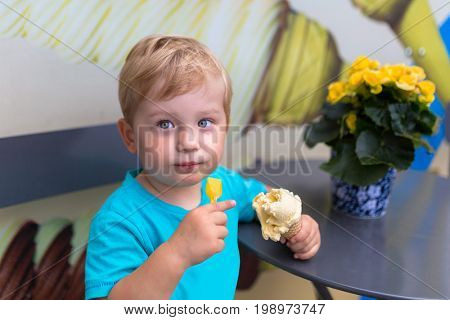 Little boy eating ice cream outdoor
