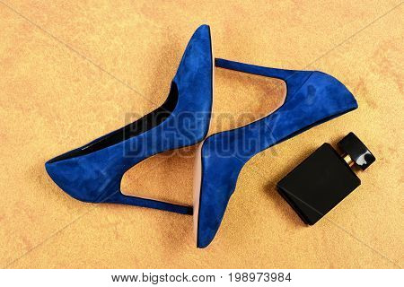 Shoes And Perfume Bottle In Blue Color. Pair Of Shoes