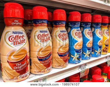 Basking Ridge NJ August 6 2017: Nestle Coffee-mate bottles stand on a shelf of a supermarket.