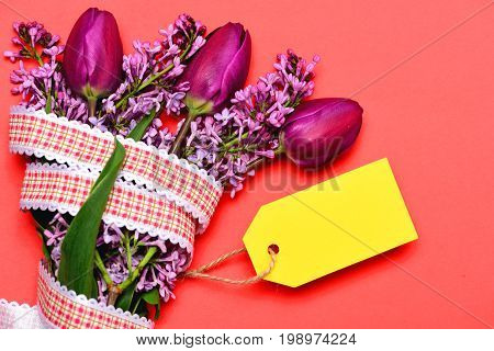 Bouquet Of Lilac And Tulips With Striking Yellow Label