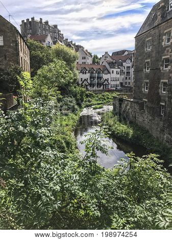 Looking down the Water of Leith flowing through picturesque Dean Village in Edinburgh Scotland