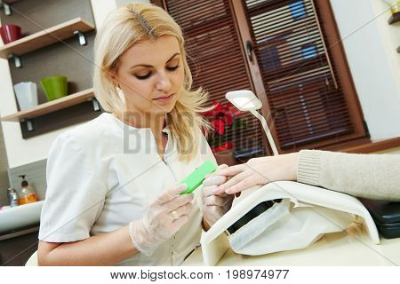 manicure and pedicure specialist in beauty salon